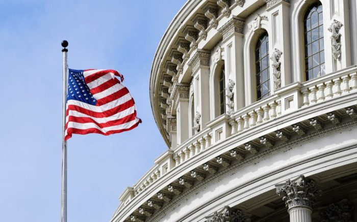 The American flag flies on Capitol Hill in WashingtonVirus Outbreak Congress, Washington, United States - 17 Mar 2020