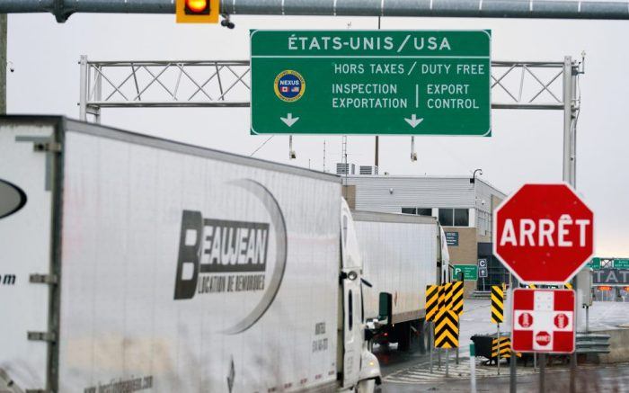 A Truck drives to pass the border to the US, Saint-Bernard-de-Lacolle, Canada, 17 March 2020. Canada announced a day earlier the closure of borders and will allow entry only to citizens and permanent residents, with minor exceptions. To date there are 453 confirmed and presumptive cases of COVID-19 coronavirus in Canada.Coronavirus in Canada, Laval - 17 Mar 2020