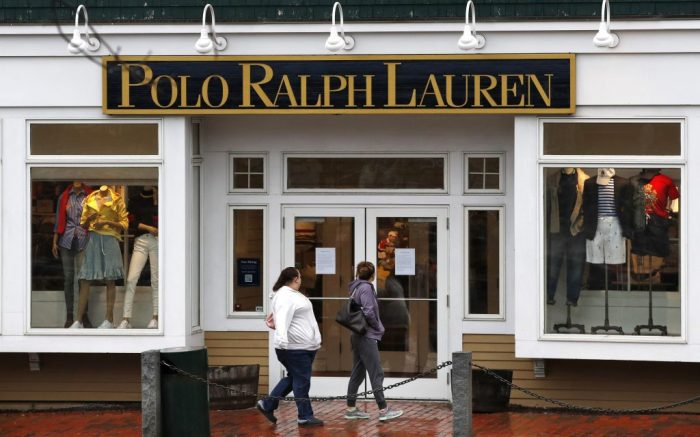 Women read a notice announcing the temporary closure of a Polo Ralph Lauren store, in Freeport, Maine. Most of the retail stores in town including the L.L. Bean flagship store were closed out of concern of spreading the coronavirusVirus Outbreak Maine, Freeport, United States - 17 Mar 2020