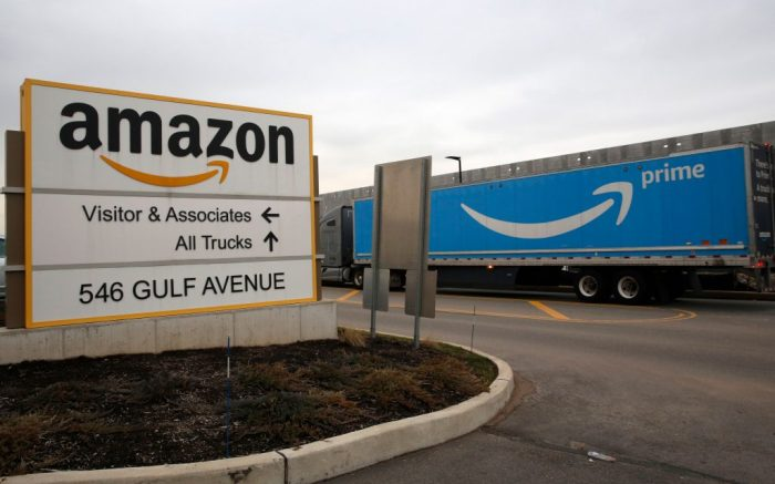 An Amazon Prime truck passes by the sign outisde an Amazon fulfillment center, in Staten Island, New York. The company's plans to add fulfillment and distribution center positions to keep up with increased demand during the coronavirus outbreakVirus Outbreak Amazon, New York, United States - 19 Mar 2020