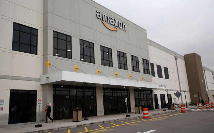 Man leaves an Amazon fulfillment center, on Staten Island, in New York. The company is hiring 100,000 new workers at it's fulfillment and distribution centers to meet increased consumer demand during the current coronavirus outbreakVirus Outbreak Amazon, New York, United States - 19 Mar 2020