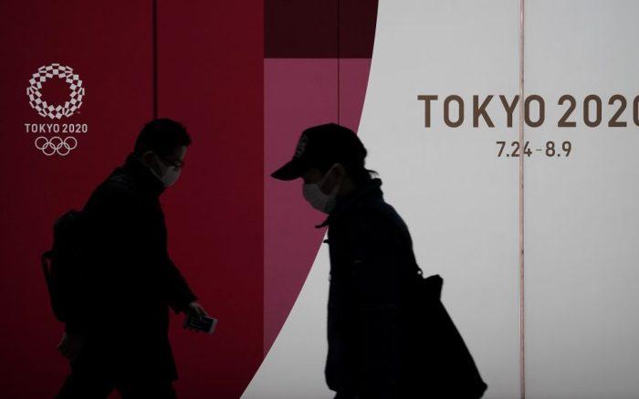 Pedestrians wearing masks walk past the emblem of the Tokyo Olympic Games in Tokyo, Japan, 23 March 2020. Japanese Prime Minister Shinzo Abe said on 23 March 2020 that postponement of the Tokyo Olympic Games may become an option if the games cannot be held in complete form due to the COVID-19 and coronavirus pandemic. On 22 March, the International Olympic Committee discussed other scenarios including a possible postponement after an emergency meeting. Earlier in the month of March, Prime Minister Abe expressed a desire to hold the Tokyo Olympics as scheduled despite the current coronavirus pandemic, during an emergency video conference with other G-7 leaders.Japanese Prime Minister Shinzo Abe suggests possibility of postoponement of the Tokyo 2020 Olympic Games, Japan - 23 Mar 2020