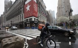 Cyclist passes Macy's in Herald Square,