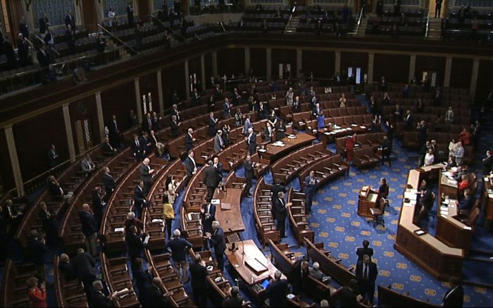 In this image from video, members of the House stand after they passed the coronavirus stimulus package on the floor of the House of Representatives at the U.S. Capitol in WashingtonVirus Outbreak Congress, Washington, United States - 27 Mar 2020