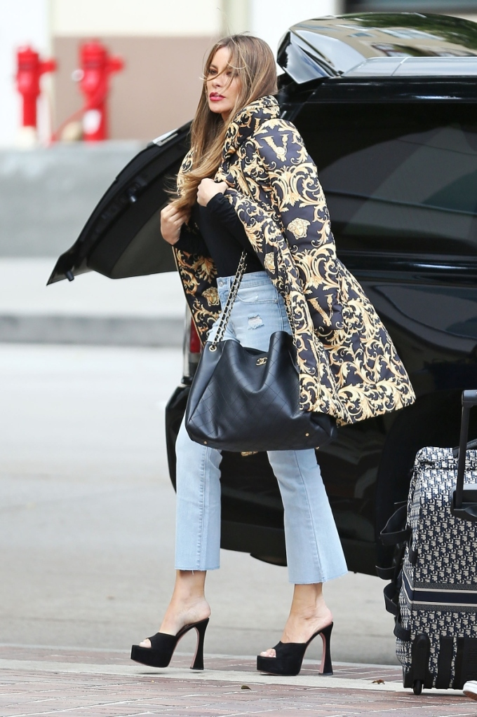 sofia vergara, platforms, america's got talent, valentino bag, jeans, rain