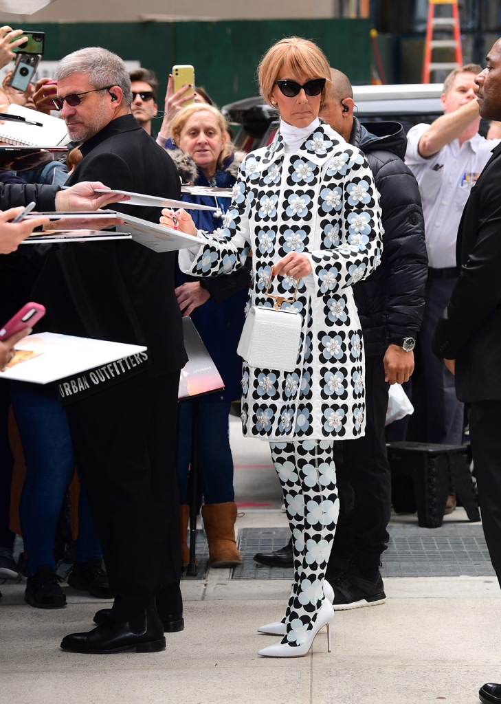 Celine Dion, Marge Sherwood bag, moncler x richard quinn, moncler genius, celebrity fashion, floral coat, tights, gianvito rossi shoes, white pumps, is a Vision in White Floral Ensemble Ahead of Her NYC Concert. She wore an outfit by Richard Quinn for Moncler, along with Feroce Sunglasses, Gianvitto Shoes and a Bag from Marge SherwoodPictured: Celine DionRef: SPL5153691 030320 NON-EXCLUSIVEPicture by: DIGGZY / SplashNews.comSplash News and PicturesLos Angeles: 310-821-2666New York: 212-619-2666London: +44 (0)20 7644 7656Berlin: +49 175 3764 166photodesk@splashnews.comWorld Rights, No Portugal RightsCeline Dion is a Vision in White Floral Ensemble Ahead of Her NYC Concert. She wore an outfit by Richard Quinn for Moncler, along with Feroce Sunglasses, Gianvitto Shoes and a Bag from Marge SherwoodPictured: Celine DionRef: SPL5153691 030320 NON-EXCLUSIVEPicture by: DIGGZY / SplashNews.comSplash News and PicturesLos Angeles: 310-821-2666New York: 212-619-2666London: +44 (0)20 7644 7656Berlin: +49 175 3764 166photodesk@splashnews.comWorld Rights, No Portugal Rights
