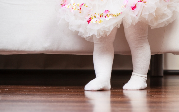 First step of baby. Part body little girl in princess fairy ballerina dress and white tights walking standing at home.; Shutterstock ID 669196108; Usage (Print, Web, Both): Web; Issue Date: 2/3