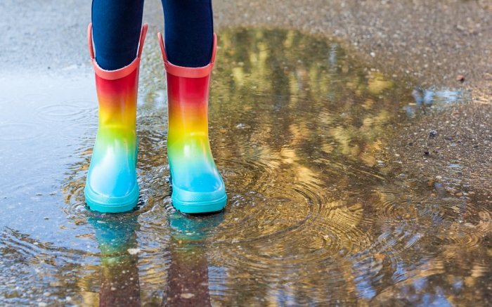 Kids in fall. close-up of a baby girls legs with rainbow rubber boots jumping into a puddle on an autumn walk. Children have fun playing outdoors. Waterproof boots for little girl; Shutterstock ID 1522513853; Usage (Print, Web, Both): Web; Issue Date: 2/3