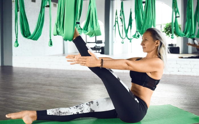 The interior shooting of senior woman practices different inversion antigravity yoga with a hammock in yoga studio. The balance between mental and physical, one person effort and achievement concept; Shutterstock ID 1235644138; Usage (Print, Web, Both): Web; Issue Date: 2/3