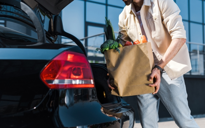 cropped view of bearded man putting paper bag in car trunk; Shutterstock ID 1410411710; Usage (Print, Web, Both): web; Issue Date: 4/9
