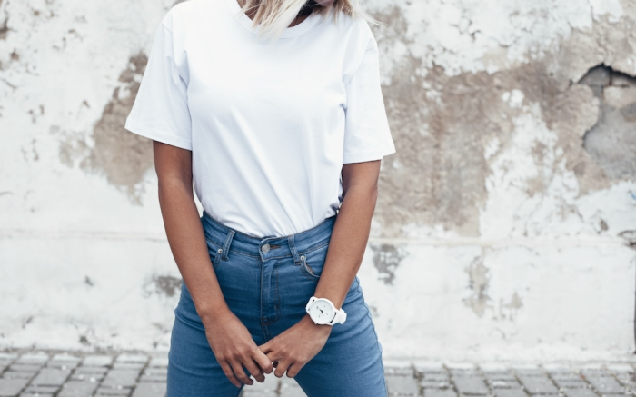 Hipster girl wearing blank white t-shirt and jeans posing against rough street wall, minimalist urban clothing style, mockup for tshirt print store; Shutterstock ID 602670041; Usage (Print, Web, Both): web; Issue Date: 3/30