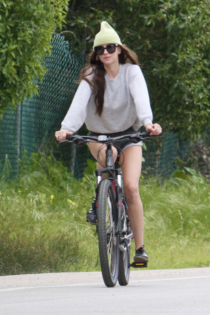 Dakota Johnson, adidas samba, bike ride, celebrity style, shorts, legs, denim cutoffs, gray sweater, gucci sunglasses, los angeles, april 2020