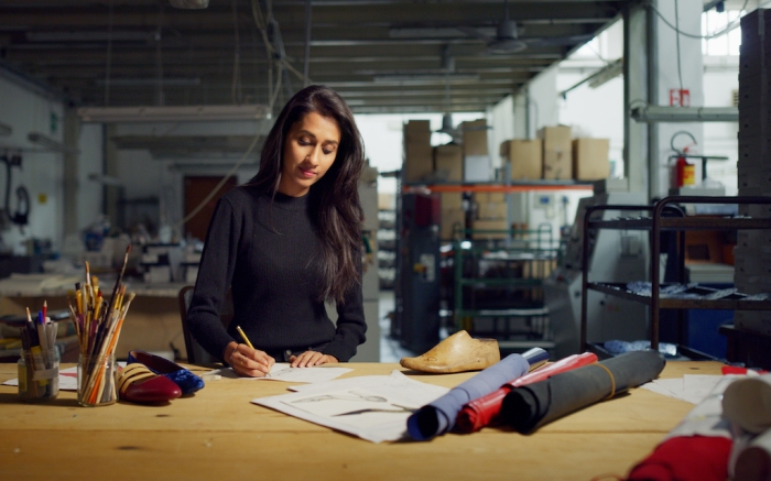 Portrait of professional fashion designer drawing a new shoe model according to the Italian tradition. Concept: fashion, design, mode, style; Shutterstock ID 1242007597; Usage (Print, Web, Both): web; Issue Date: 3/30