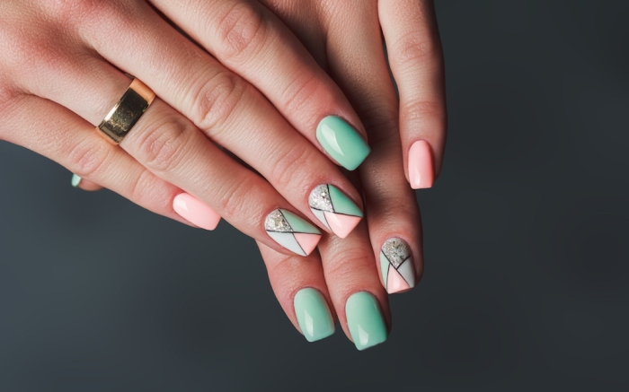 Geometry nail art design in pink and green colors on dark background; Shutterstock ID 714538768; Usage (Print, Web, Both): web; Issue Date: 4/9