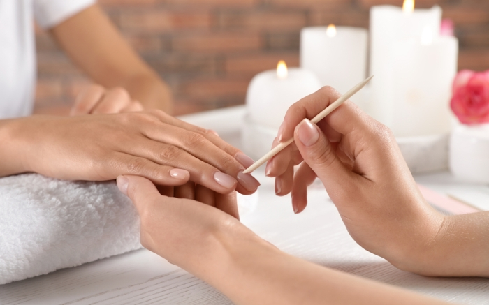 Manicurist working with client's nails at table, closeup. Spa treatment; Shutterstock ID 1414233125; Usage (Print, Web, Both): web; Issue Date: 4/9