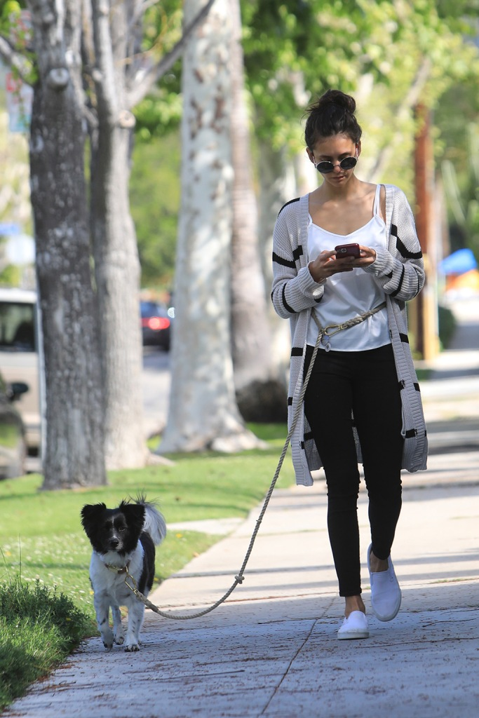 Nina Dobrev, striped cardigan, citizens for humanity jeans, skinny jeans, vans sneakers, vans classic slip-on, out with her dog in West Hollywood. 07 Apr 2020 Pictured: Nina Dobrev. Photo credit: MEGA TheMegaAgency.com +1 888 505 6342 (Mega Agency TagID: MEGA643291_015.jpg) [Photo via Mega Agency]