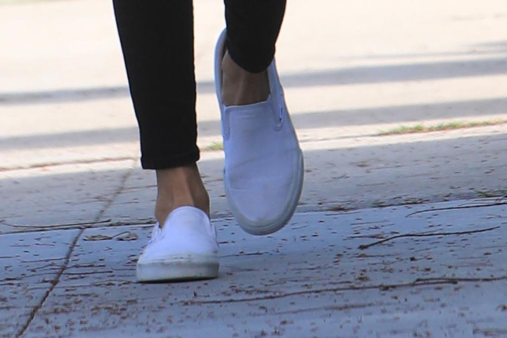 Nina Dobrev Wears Skinny Jeans + Vans Slip On Sneakers to
