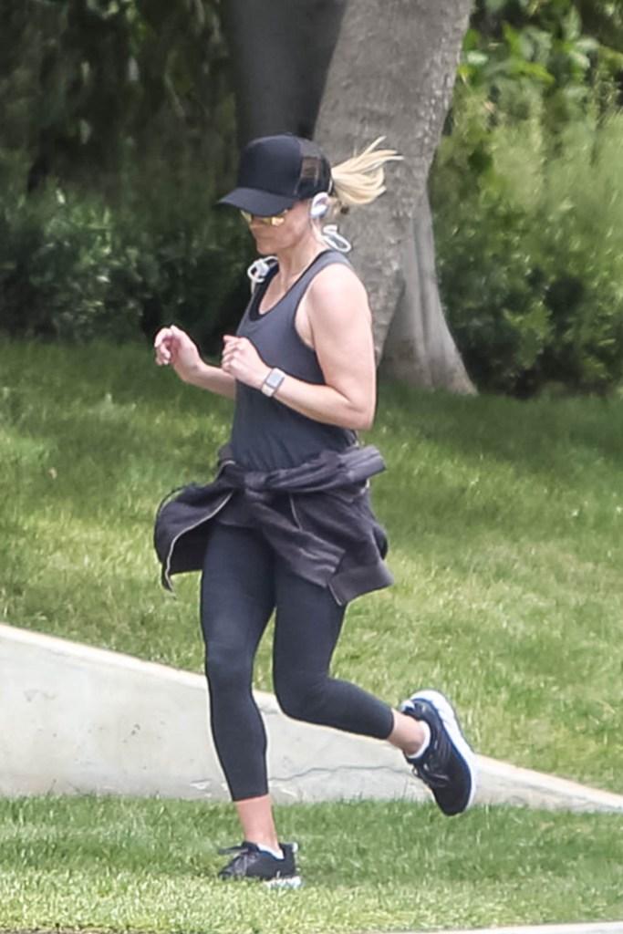 Reese Witherspoon , leggings, tank top, sweatshirt, apple watch, baseball cap, aviator sunglasses, hoka one one sneakers, los angeles, celebrity fashion