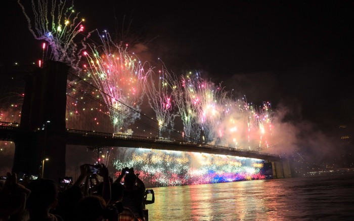 Fireworks light up the Brooklyn Bridge during the annual Macy's fireworks show on the East RiverIndependence Day Celebrations, New York, USA - 04 Jul 2019