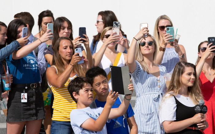 Visitors use an application on their mobile phones to see an augmented reality (AR) placement of the Saturn Rocket that was used for the Apollo 11 mission, on the water in front of the JFK Library and Museum on the 50th anniversary of the Moon Shot, in Boston, Massachusetts, USA, 16 July 2019. Fans gathered to watch an AR replay of the mission launch exactly 50 years later at 9:32 AM EST at the museum. The day also marks the 20th anniversary of the death of John F Kennedy Jr., the former President's grandson, and his wife Carolyn Bessette-Kennedy off the coast of Martha's Vineyard, when the younger Kennedy became disoriented while flying at night over water and crashed in 1999.Celebrations of 50th anniversary of the Apollo 11 Mission to the Moon at JFK Library and Musem, Boston, USA - 16 Jul 2019