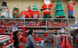 People shop in a holiday section
