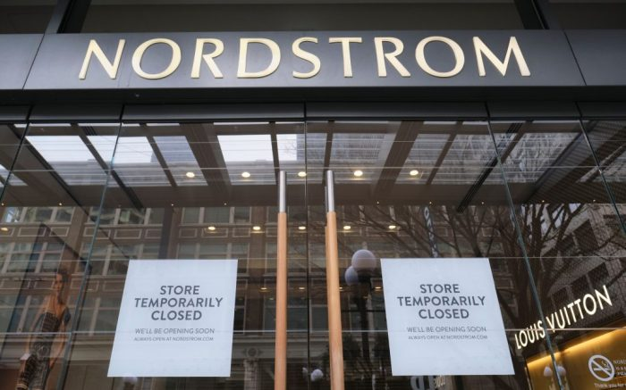 Signs annoucing the closure of the Nordstrom headquarters flagship store pare picture in Seattle, Washington, USA, 17 March 2020. Many businesses throughout the area were closed and restaurants were offering takeout only because of the novel coronavirus COVID-19 outbreak.Washington State Response to COVID-19, Seattle, USA - 17 Mar 2020