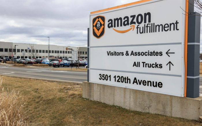 The Amazon Fulfillment Center parking lot is full in Kenosha, Wisconsin, USA, 30 March 2020. While many businesses have closed because of the coronavirus SARS-CoV-2 which causes the Covid-19 disease, online companies continue to hire employees and make deliveries of needed items.Amazon fulfillment center in Kenosha, Wisconsin, USA - 30 Mar 2020