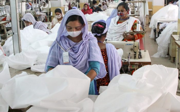 Workers use sewing machines to manufacture protective suits at a garment factory during the lockdown imposed by the government amid concerns about the spread of Coronavirus pandemic in Dhaka.Bangladesh has confirmed 51 cases, with 5 deaths due to corona virus (COVID-19), According to the IEDCR officials.Manufacturing of protective suits at a garment factory in Dhaka, Bangladesh - 31 Mar 2020