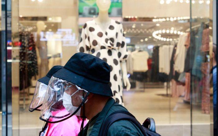 People wear masks on the street in Hong Kong. Hong Kong close Public park, gym, nightclub, and karaoke for 2 weeks in order to curb COVID-19.Hong Kong under Corvid 19, Hong Kong, China - 01 Apr 2020