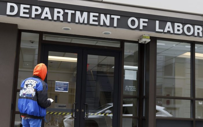 A man looks into the closed offices of the New York State Department of Labor in Brooklyn, New York, USA, on 03 April 2020. The unemployment rate in the United States for March was reported to have risen to 4.4%, according numbers released to day by the U.S. Department of Labor, as the national economy begins to show the large impact from state and city responses to the coronavirus pandemic. New York City is still considered the epicenter of the coronavirus outbreak in the United States and hospital workers dealing with Covid-19 patients are struggling with a limited supply of protective equipment.New York Coronavirus Unemployment, Brooklyn, USA - 03 Apr 2020