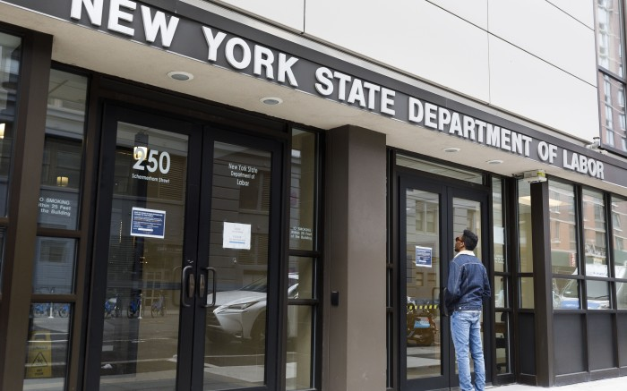 A man reads a sign on the door on the closed offices of the New York State Department of Labor in Brooklyn, New York, USA, on 03 April 2020. The unemployment rate in the United States for March was reported to have risen to 4.4%, according numbers released to day by the U.S. Department of Labor, as the national economy begins to show the large impact from state and city responses to the coronavirus pandemic. New York City is still considered the epicenter of the coronavirus outbreak in the United States and hospital workers dealing with Covid-19 patients are struggling with a limited supply of protective equipment.New York Coronavirus Unemployment, Brooklyn, USA - 03 Apr 2020