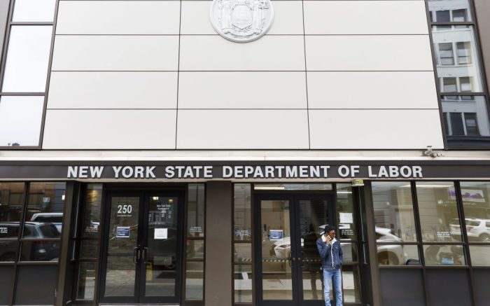 A man calls a number posted on the a sign on the door on the closed offices of the New York State Department of Labor in Brooklyn, New York, USA, on 03 April 2020. The unemployment rate in the United States for March was reported to have risen to 4.4%, according numbers released to day by the U.S. Department of Labor, as the national economy begins to show the large impact from state and city responses to the coronavirus pandemic. New York City is still considered the epicenter of the coronavirus outbreak in the United States and hospital workers dealing with Covid-19 patients are struggling with a limited supply of protective equipment.New York Coronavirus Unemployment, Brooklyn, USA - 03 Apr 2020