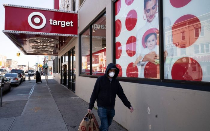 Customer wearing a mask carries his purchases as he leaves a Target store during the coronavirus pandemic, in the Brooklyn borough of New YorkVirus Outbreak , New York, United States - 06 Apr 2020