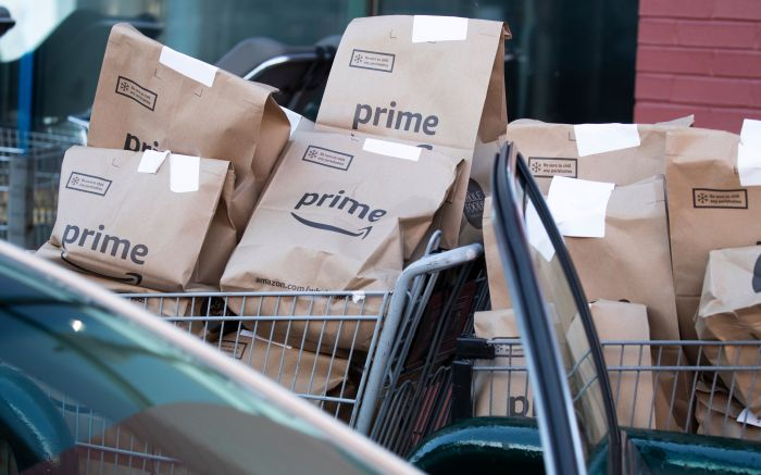 Bags of groceries are seen in a cart before being loaded into a vehicle by an Amazon driver outside a Whole Foods Market store in Silver Spring, Maryland, USA, 07 April 2020. During the coronavirus COVID-19 pandemic, Amazon has seen a surge in demand from Prime members for the two-hour delivery service of grocery items from the company's subsidiary, Whole Foods Market.Whole Foods Market grocery deliveries with Amazon Prime during the coronavirus COVID-19 pandemic, Silver Spring, USA - 07 Apr 2020