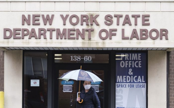 A person walks past an office of the New York State Department of Labor closed due to the COVID-19 pandemic in New York, New York, USA, 09 April 2020. Some 16 million people lost their jobs in the past three weeks as unemployment rate in the United States is rising with the national economy showing the large impact from state and city responses to the coronavirus pandemic. New York City is still considered the epicenter of the coronavirus outbreak in the United States and hospital workers dealing with COVID-19 patients are struggling with a limited supply of protective equipment.Unemployment in New York due to Coronavirus, USA - 09 Apr 2020