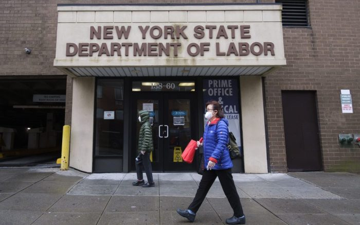 People walk past of an office of the New York State Department of Labor closed due to the COVID-19 pandemic in New York, New York, USA, 09 April 2020. Some 16 million people lost their jobs in the past three weeks as unemployment rate in the United States is rising with the national economy showing the large impact from state and city responses to the coronavirus pandemic. New York City is still considered the epicenter of the coronavirus outbreak in the United States and hospital workers dealing with COVID-19 patients are struggling with a limited supply of protective equipment.Unemployment in New York due to Coronavirus, USA - 09 Apr 2020