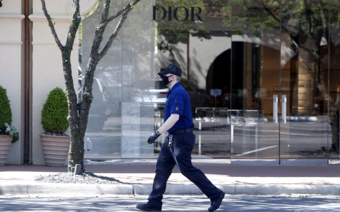 Amid concerns for the spread of COVID19, man walks an empty parking lot in front of a closed Dior retail store at a shopping center in Highland Park, Texas, . The first U.S. economic indicators to capture the devastation brought on by the pandemic have begun to arrive. The plunge in retail sales exceeded what happened during the economic crisis a decade ago and industrial production posted the biggest declines since the United States demobilized after World War IIVirus Outbreak Retail, Dallas, United States - 15 Apr 2020
