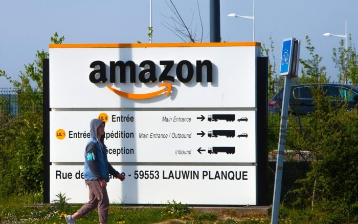 "Man walks at the entrance of Amazon, in Douai, northern France, . Amazon has decided to suspend ""temporarily"" all activity in France, one day after a French court found it wasn't doing enough to protect its workers amid the virus crisis in the country. The online giant, which has six warehouses in France, said in a statement Wednesday that ""this week, we are requesting employees of our distribution centers to stay at home. On the longer term, we will evaluate the impact of that (justice) decision for them and our French logistic networkVirus Outbreak Amazon, Douai, France - 16 Apr 2020"