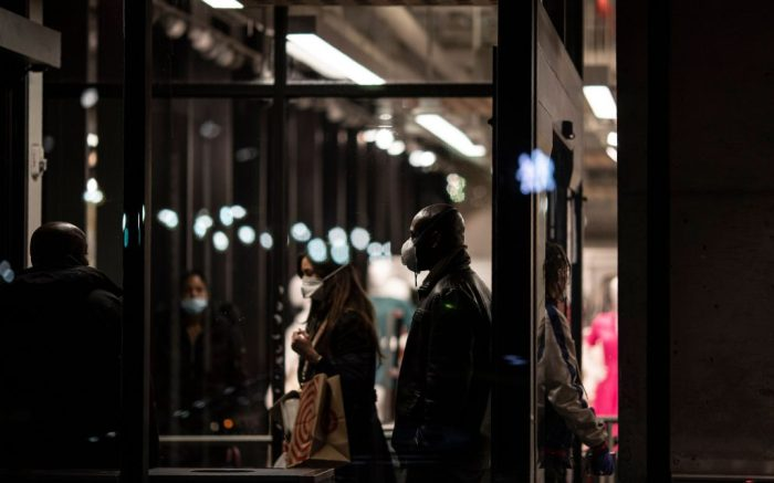 Shoppers wearing face masks enter and exit a Target store in the East Village neighborhood of New York onVirus Outbreak Daily Life, New York, United States - 22 Apr 2020