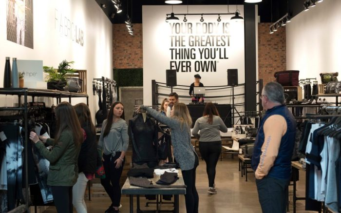 Shoppers look at clothing and other apparel during the grand opening of the HPE store at the Polaris Fashion Place, in Columbus, OhioPolaris Fashion Place Holiday & HPE Grand Opening, Columbus, USA - 18 Nov 2018