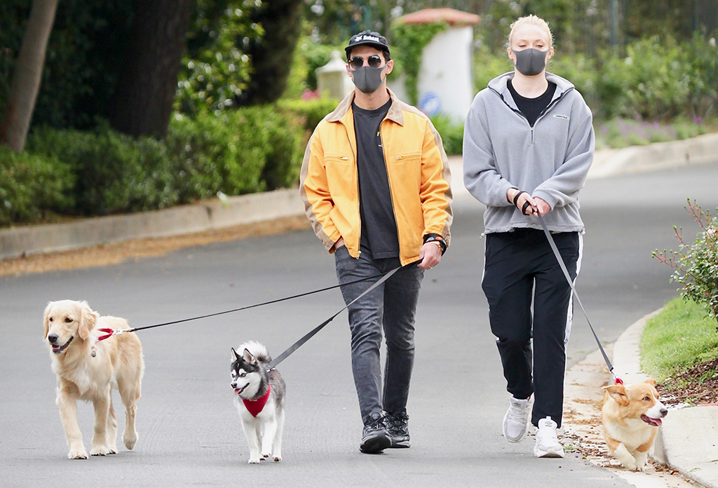 sophie turner, umbro sneakers, celebrity style, Joe Jonas steps out of quarantine to walk his dogs with wife Sophie Turner. 20 Apr 2020 Pictured: Joe Jonas steps out of quarantine to walk his dogs with wife Sophie Turner. Photo credit: MEGA TheMegaAgency.com +1 888 505 6342 (Mega Agency TagID: MEGA650382_006.jpg) [Photo via Mega Agency]