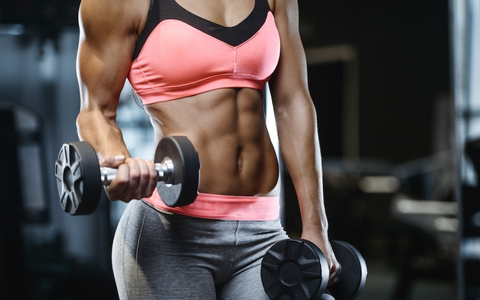 Beautiful strong sexy athletic muscular young caucasian fitness girl workout training in the gym on diet pumping up abs muscles and posing bodybuilding health care and fitness concept; Shutterstock ID 1039922533; Usage (Print, Web, Both): web; Issue Date: 4/9