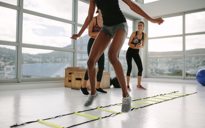 Woman training on agility ladder in gym. Fitness class cardio workout with speed ladder no floor.; Shutterstock ID 1037615185; Usage (Print, Web, Both): web; Issue Date: 4/9