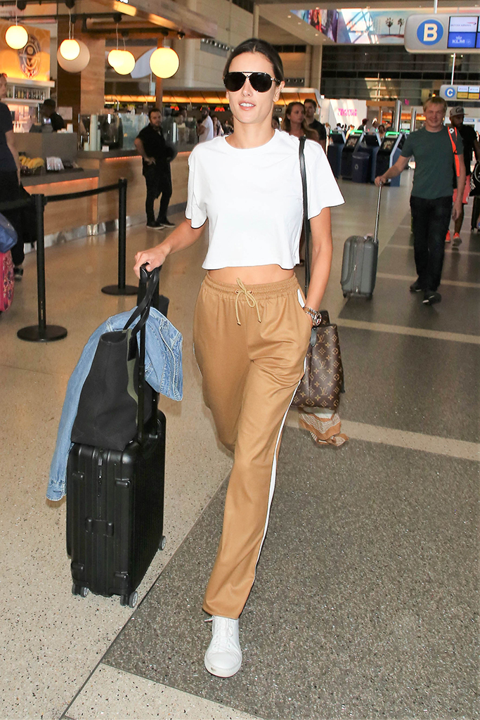 Alessandra Ambrosio, crop top, brown pants, common projects sneakers, street style, fashion, Alessandra Ambrosio at LAX International Airport, Los Angeles, USA - 26 Sep 2017