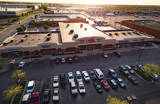 Overhead shot of shopping center Shoppes at Bedford Park by Time Equities Retail