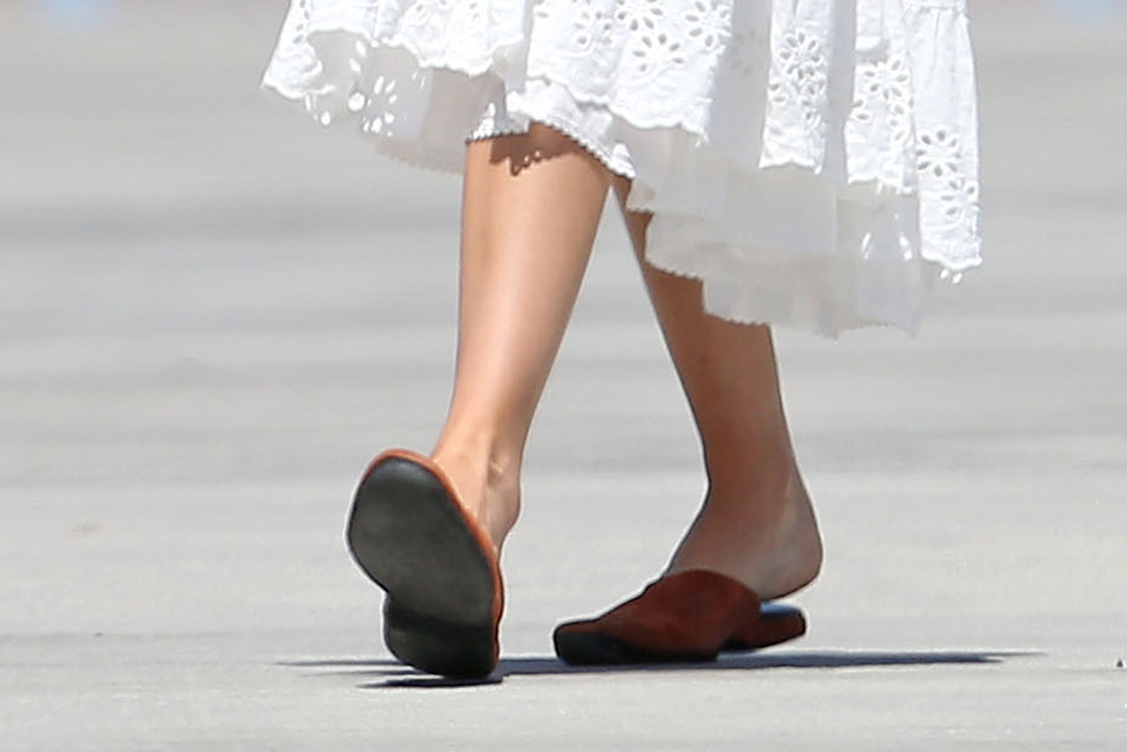 Dakota Johnson, charvet, tan slippers, suede slip-on shoes