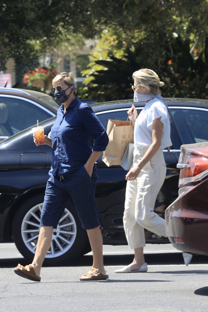 "EXCLUSIVE: Ellen DeGeneres and Portia DeRossi who have been staying inside their fancy home in Santa Barbara, take a break from being cooped up what Ellen described as, her ""prison"" and head out in their convertible Porsche. The 62 year-old comedian and her 47 year-old wife are spotted enjoying a bit of a wander around Santa Barbara on Memorial Day while wearing masks to guard against possible spreading coronavirus. Seen here heading back to their car, Portia is carrying a bag from Wendy Foster where she seemed like one particular dress. She'd modeled it for Ellen, who pulled her mask down to drink her iced-tea while watching. 23 May 2020 Pictured: Ellen Degeneres, Portia DeRossi. Photo credit: Rachpoot/P&P/MEGA TheMegaAgency.com +1 888 505 6342 (Mega Agency TagID: MEGA670855_001.jpg) [Photo via Mega Agency]"