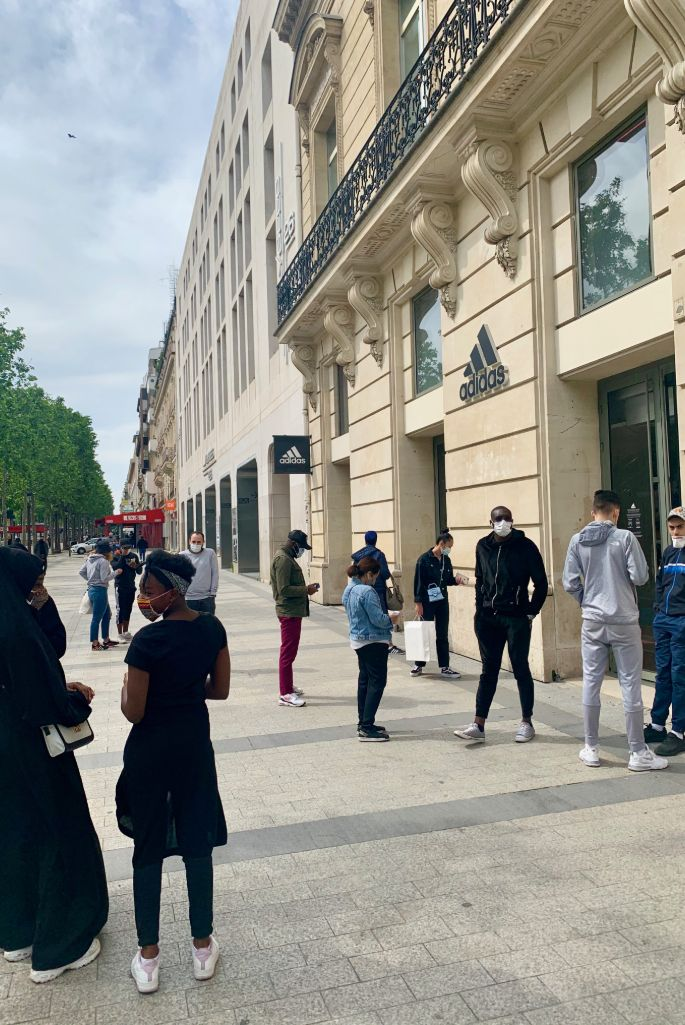 Customers awaiting the opening of the Adidas flagship store on Champs-Élysées