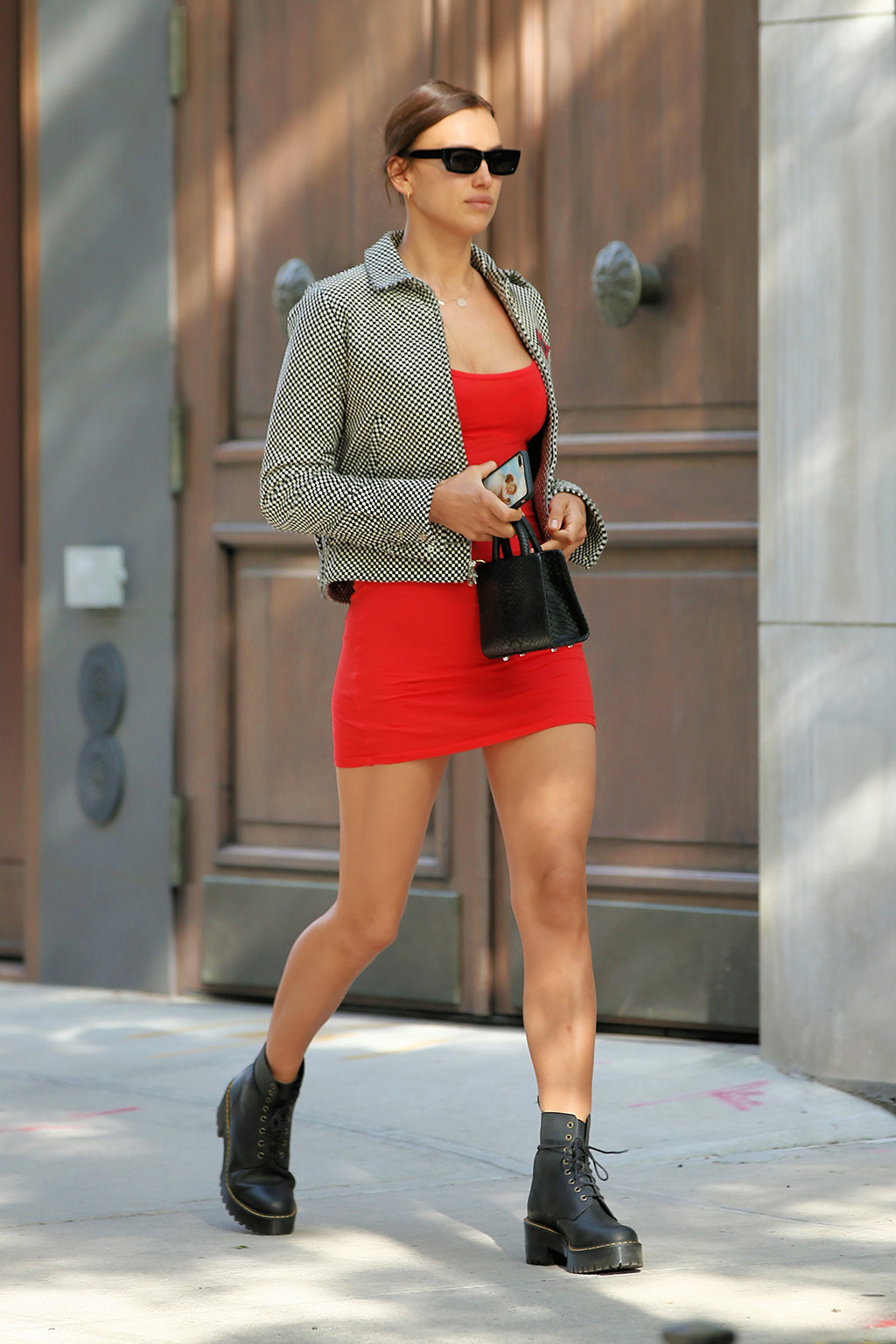 irina shayk, celebrity style, minidress, legs, dr martens boots, chrome hearts jacket, bradley cooper ex, Model Irina Shayk is seen in a short red dress, Chrome Hearts short-waisted jacket, lace-up boots and little hand bag in New York City on May 27, 2020.Pictured: Irina ShaykRef: SPL5168793 270520 NON-EXCLUSIVEPicture by: Christopher Peterson / SplashNews.comSplash News and PicturesUSA: +1 310-525-5808London: +44 (0)20 8126 1009Berlin: +49 175 3764 166photodesk@splashnews.comWorld Rights