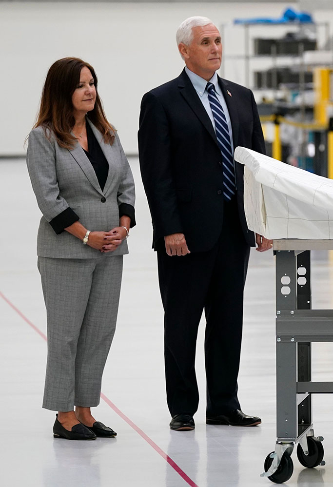 President Donald Trump signs a piece of equipment as he and first lady Melania Trump participate in a tour of NASA facilities before viewing the SpaceX Demonstration Mission 2 Launch at Kennedy Space Center, in Cape Canaveral, Fla. Vice President Mike Pence, second from left, second lady Karen Pence, left, and NASA Administrator Jim Bridenstine look onTrump SpaceX, Cape Canaveral, United States - 27 May 2020